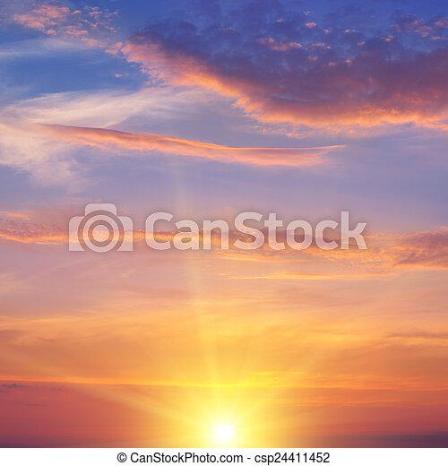 the sun rays illuminate the sky above the horizon - csp24411452