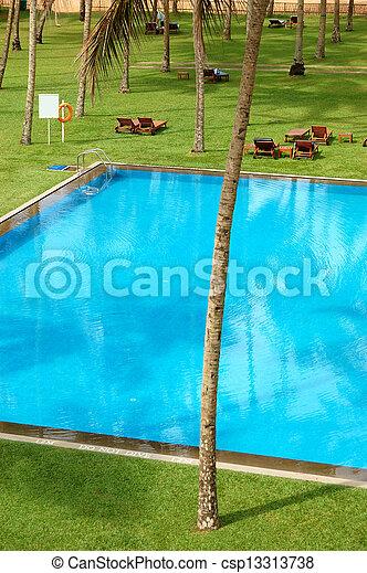 The swimming pool and green lawn at luxury hotel, Bentota, Sri Lanka - csp13313738