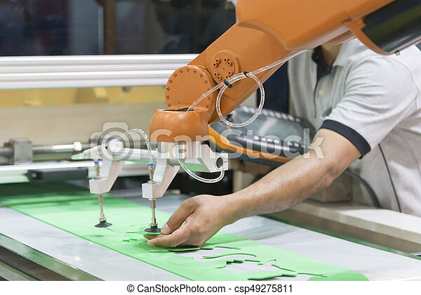 The technician operator adjust the automatic robot arm  Industrial 4 0  concept Modern technology for manufacturing