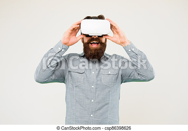 The technology is here. Hipster explore VR technology yellow background. Bearded man wear VR glasses. VR technology and future. Taking advantage of new technology - csp86398626