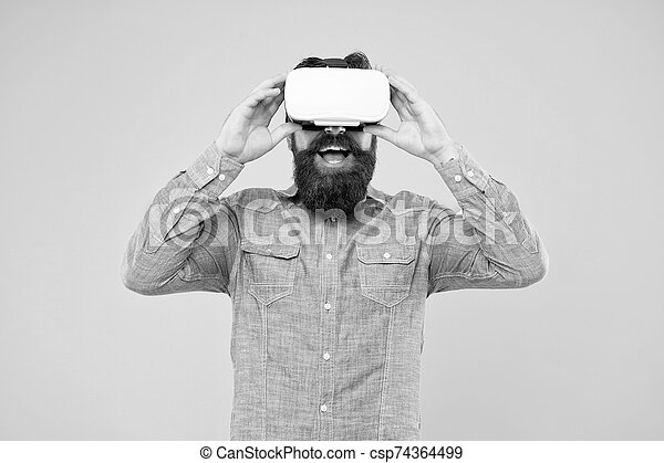 The technology is here. Hipster explore VR technology yellow background. Bearded man wear VR glasses. VR technology and future. Taking advantage of new technology - csp74364499