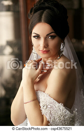 The tenderness bride stands in the room - csp43675521