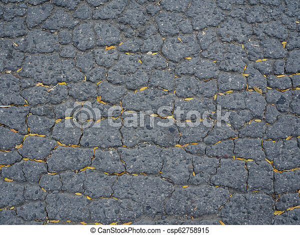The texture of old asphalt with cracks. - csp62758915