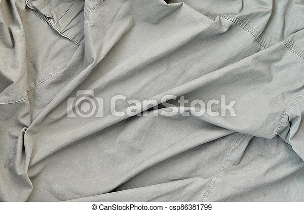 The texture of the fabric is olive-colored, which is similar to the uniform of American soldiers of the Second World War - csp86381799