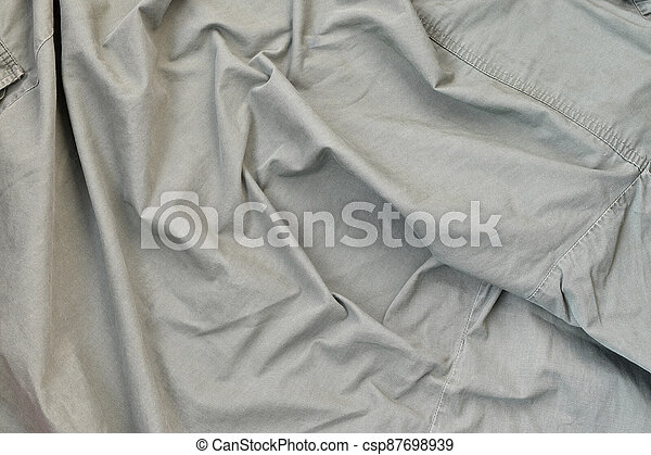 The texture of the fabric is olive-colored, which is similar to the uniform of American soldiers of the Second World War - csp87698939