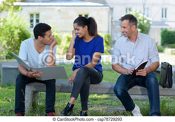 the three students are outdoors - csp78729293
