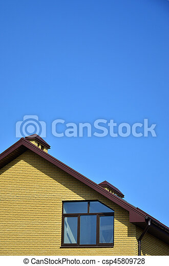 The top of a residential building of yellow brick - csp45809728