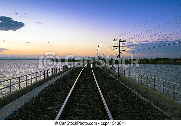 the track of railway or railroad with the morning twilight sky before the sunrise - csp41343841