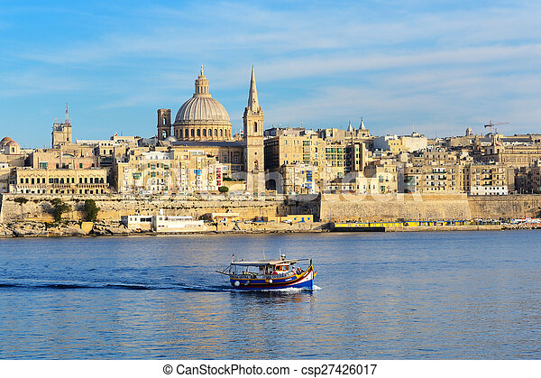 The traditional Maltese Luzzu boat for tourists cruises and view on Valletta, Sliema, Malta - csp27426017
