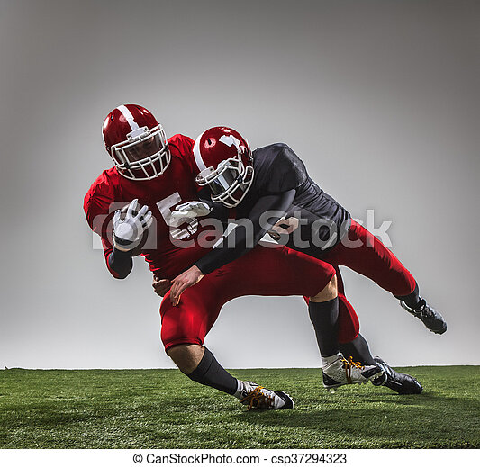 The two american football players in action - csp37294323