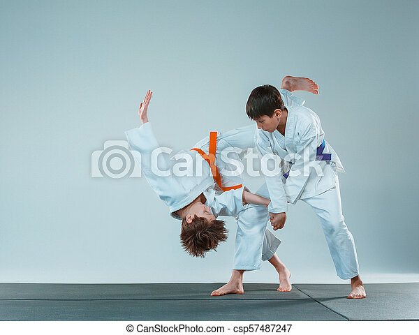 5884f5c32817d The Two Boys Fighting At Aikido Training In Martial Arts School. Healthy  Lifestyle And Sports