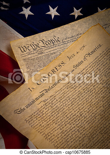 The United States Constitution and Declaration of Independence on a flag background - csp10675885