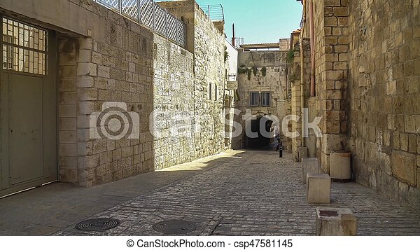 The Via Dolorosa is the narrow street inside the walled town - csp47581145