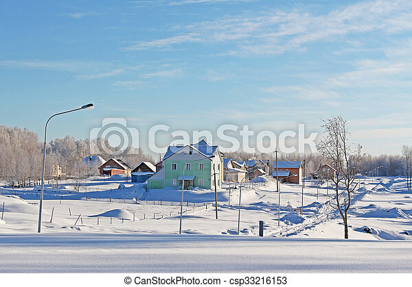 The village in a sunny day in cold winter - csp33216153