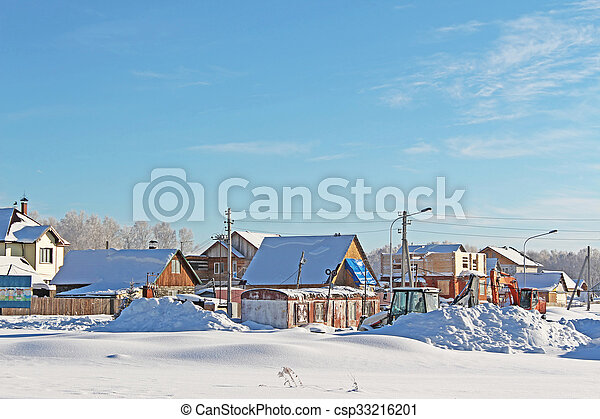 The village in a sunny day in cold winter - csp33216201
