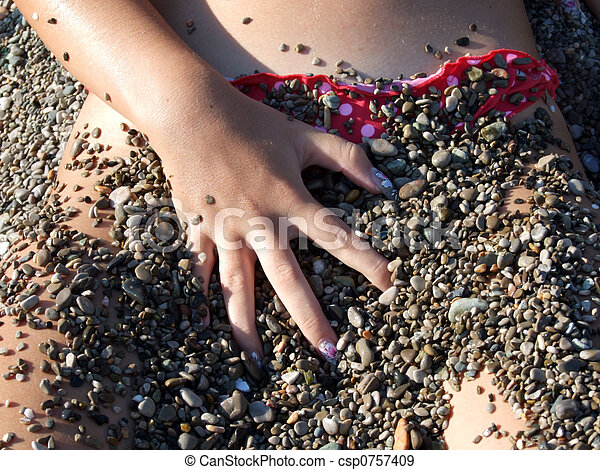 The woman in a pebbles - csp0757409