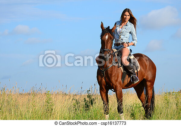 The woman on a horse in the field - csp16137773