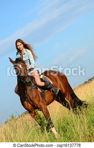 The woman on a horse in the field - csp16137778