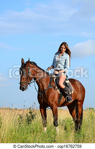 The woman on a horse in the field - csp16762759