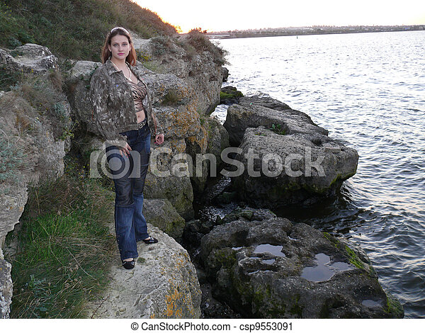 The woman on the rocks - csp9553091