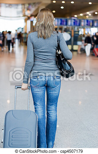 The woman with luggage at the airport - csp4507179