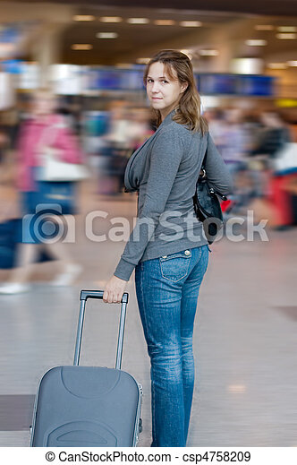 The woman with luggage at the airport - csp4758209