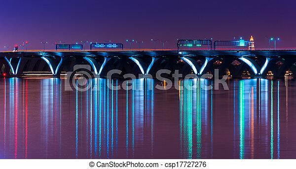 The Woodrow Wilson Bridge at night, seen from National Harbor, Maryland. - csp17727276