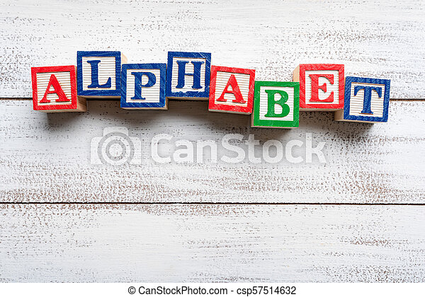The word -alphabet- spelled with wooden block letters - csp57514632