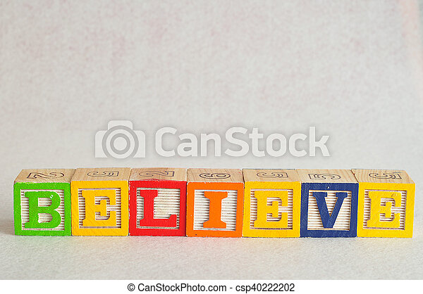 The word believe spelled with colorful alphabet blocks isolated against a white background - csp40222202