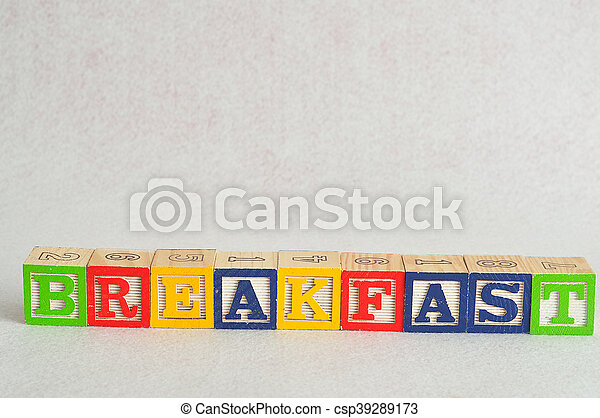 The word breakfast spelled with alphabet blocks isolated on a white background - csp39289173