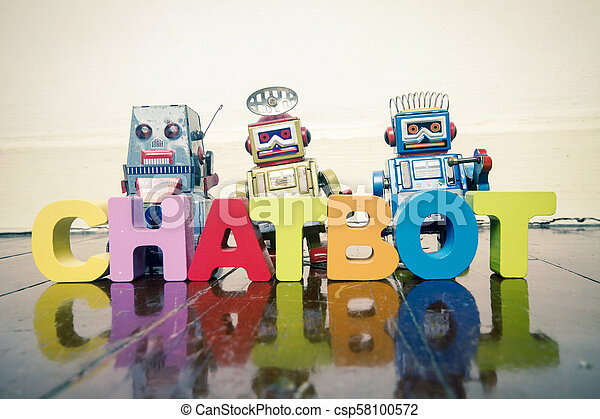 the word CHAT BOT with wooden letters and retro toy robots on an old wooden floor - csp58100572