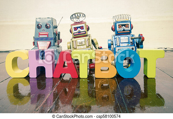 the word CHAT BOT with wooden letters and retro toy robots on an old wooden floor - csp58100574