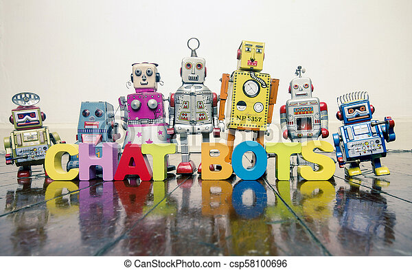 the word CHAT BOTS with wooden letters and retro toy robots on an old wooden floor - csp58100696