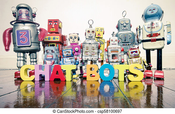 the word CHAT BOTS with wooden letters and retro toy robots on an old wooden floor - csp58100697