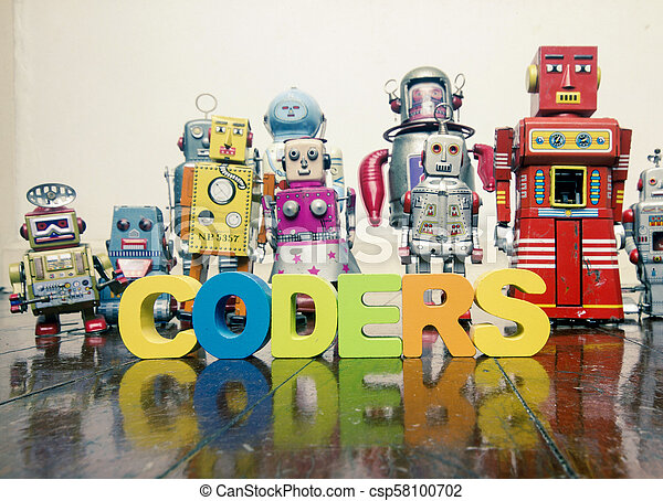 the word CODERS with wooden letters and retro toy robots on an old wooden floor - csp58100702