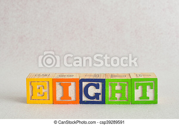 The word eight (8) spelled with colorful alphabet blocks isolated against a white background - csp39289591