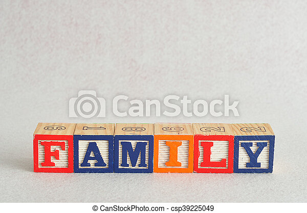 The word family spelled with alphabet blocks isolated on a white background - csp39225049