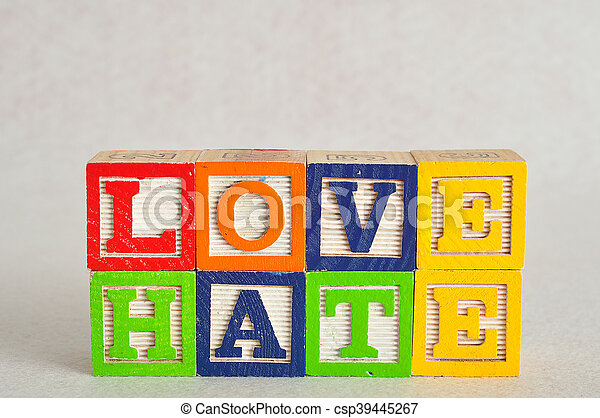 The word love and hate spelled with colorful alphabet blocks isolated on white background - csp39445267