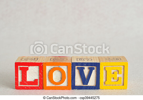 The word love spelled with colorful alphabet blocks isolated on white background - csp39445275