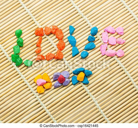 The word LOVE spelled with colorful stones - csp16421445