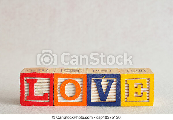 The word love spelled with colorful blocks isolated on a white background - csp40375130