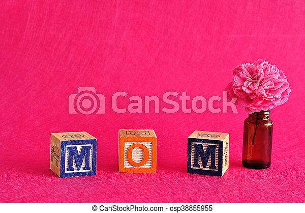 The word mom spelled with alphabet - csp38855955