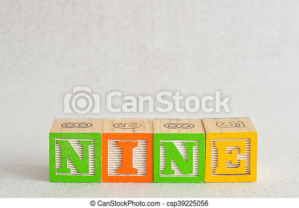 The word nine (9) spelled with colorful alphabet blocks isolated against a white background - csp39225056
