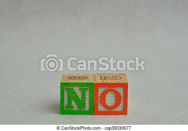 The word no spelled with colorful alphabet blocks isolated against a white background - csp39330677