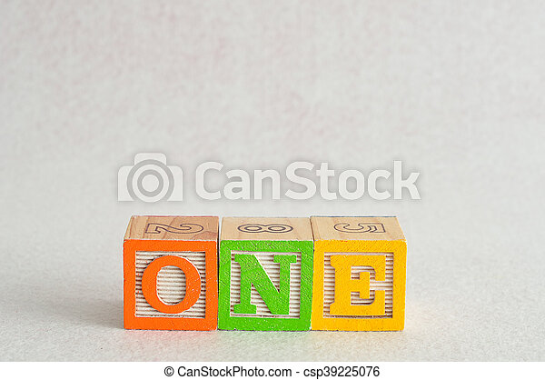 The word one (1) spelled with colorful alphabet blocks isolated against a white background - csp39225076