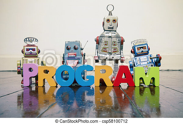 the word PROGRAM with wooden letters and retro toy robots on an old wooden floor - csp58100712