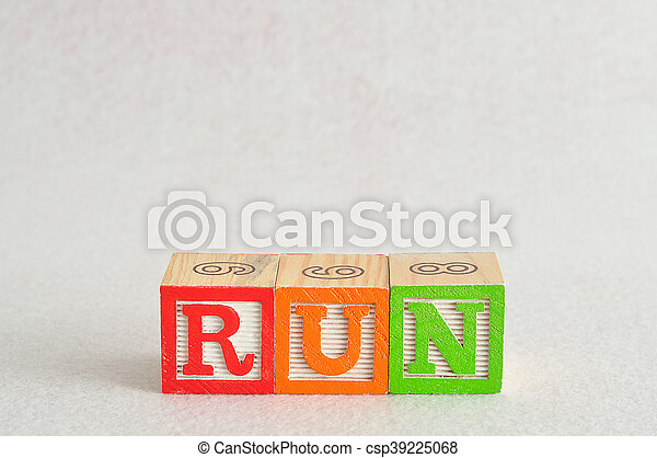 The word run spelled with alphabet blocks isolated on a white background - csp39225068