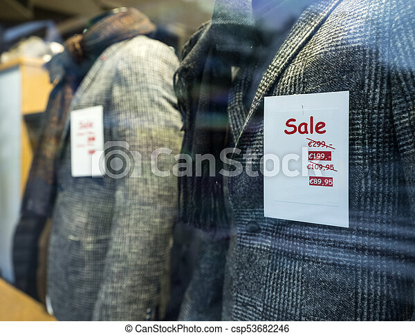 87c4bb69ff2 The word sale in shop window of clothing store. The word sale on ...