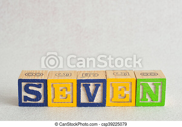 The word seven (7) spelled with colorful alphabet blocks isolated against a white background - csp39225079