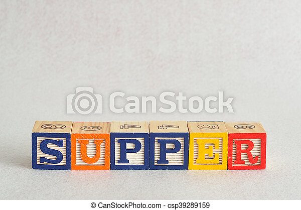 The word supper spelled with alphabet blocks isolated on a white background - csp39289159